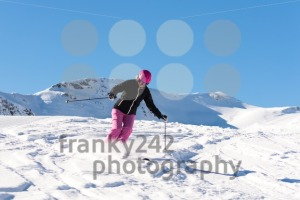 Female skier in fresh powder snow - franky242 photography
