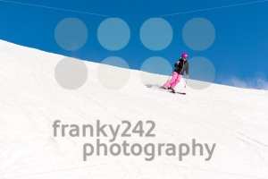 Female skier in fresh powder snow and blue sky - franky242 photography