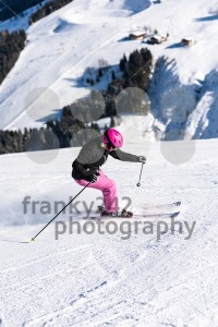 Female skier in fresh powder snow and skiing huts - franky242 photography
