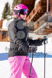 Female skier in front of skiing hut - franky242 photography