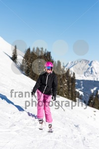 Female skier in front of trees and mountains - franky242 photography