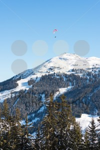 Paragliding over skiing area in the Austrian Alps - franky242 photography
