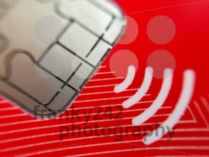 A closeup of credit card chip with wireless symbol - franky242 photography