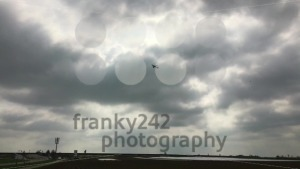 Airplane flying over fields in dramatic sky - franky242 photography