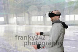 Architect with VR visor exploring industrial building environment - franky242 photography