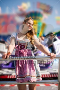 Attractive young woman at German funfair Oktoberfest with traditional dirndl dress - franky242 photography