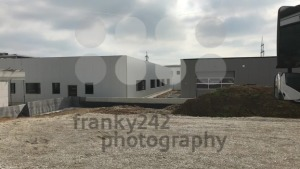 Booming logistics - panorama of a van in front of newly built warehouses - franky242 photography