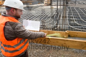 Construction supervisor with plan marking the site - franky242 photography