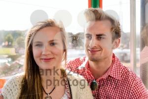 Couple inside a Ferris wheel on Oktoberfest - franky242 photography