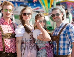 Group of happy friends celebrating Oktoberfest - franky242 photography