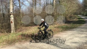Woman on e-bike in forest - franky242 photography