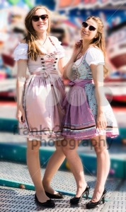 Attractive young women at German funfair Oktoberfest with traditional dirndl dresses - franky242 photography