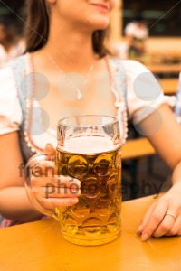 Beautiful young woman with beer stein at Munich Oktoberfest - franky242 photography