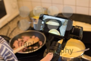 Blogger making smartphone video while cooking - franky242 photography