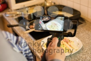 Blogger making smartphone video while preparing an asparagus dish - franky242 photography
