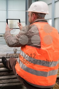 Construction supervisor with digital tablet on site - franky242 photography