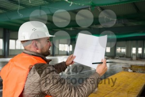 Construction supervisor with plan on site - franky242 photography