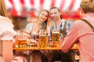 Young couple in love at Oktoberfest beer tent - franky242 photography