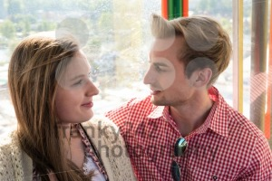 Young couple inside a Ferris wheel on Oktoberfest - franky242 photography