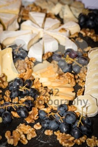 Cheese platter with different cheese, walnuts and grapes - franky242 photography