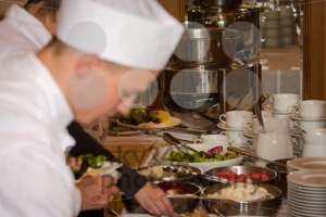 Cook preparing food buffet in a restaurant during a festive event - franky242 photography