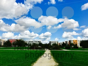 Modern apartment buildings with meadows and cloudy sky - franky242 photography