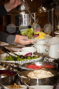 People are picking food from a buffet in a restaurant during a festive event - franky242 photography