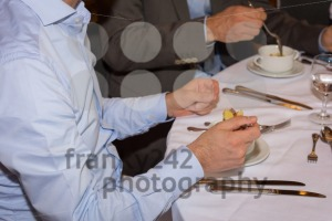 Young handsome businessman eating a soup for lunch - franky242 photography
