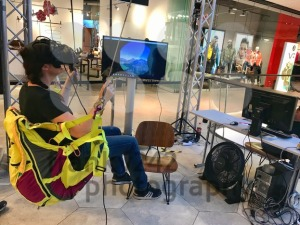 A girl is wearing virtual reality goggles in a shopping mall - franky242 photography