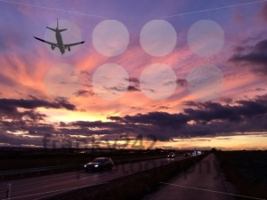 A plane is approaching Stuttgart AIrport during a dramatic sunset - franky242 photography