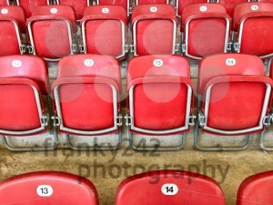 Bright red plastic seats in a stadium - franky242 photography