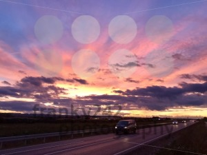 Cars driving during dramatic sunset - franky242 photography
