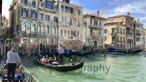 Gondoliers at the famous Rialto Bridge of Venice, Italy - franky242 photography