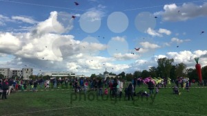 Hundreds of kites are soaring in the sky during the kite festival on the German Reunification Day - franky242 photography