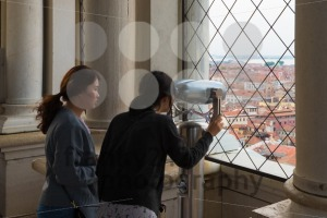 Two asian tourist girls are looking on Piazza San Marco from the bell tower of St Mark's Campanile (Campanile di San Marco) in Venice, Italy - franky242 photography
