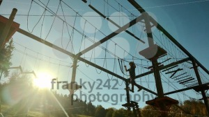 Unidentifiable boy climbing in high rope park - franky242 photography