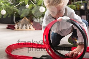 Boy playing with Christmas present - franky242 photography