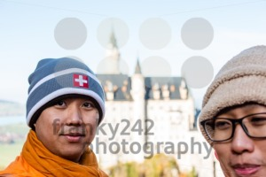 Buddhist monks in front of world-famous Neuschwanstein Castle - franky242 photography