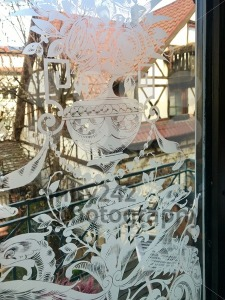 Ancient half-timbered house as seen through a richly decorated window - franky242 photography