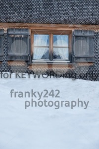 Winter landscape reflected in window of a chalet - franky242 photography