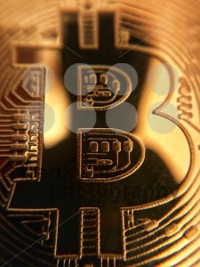 closeup of a golden bitcoin - franky242 photography