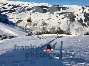 female snowboarder on piste - franky242 photography