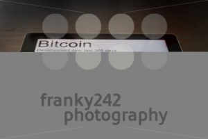 Bitcoins and rising chart on digital tablet - franky242 photography