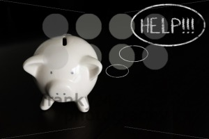 Piggy bank with thought bubbles, thinking HELP - franky242 photography