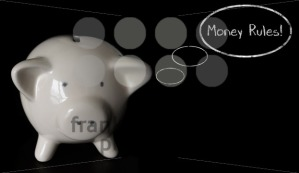 Piggy bank with thought bubbles, thinking MONEY RULES! - franky242 photography