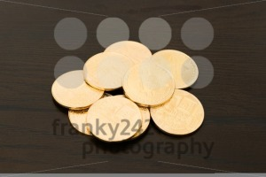 heap of golden bitcoins - franky242 photography