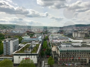 Stuttgart, Germany - May 24, 2013: Famous shopping promenade Koenigstrasse, between Koenigsbau and Schlossplatz square. On the right, the new art museum, a modern building with glass facade. - franky242 photography
