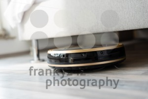 Robot vacuum cleaner runs under bed - franky242 photography