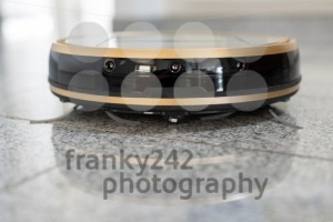 Robotic vacuum cleaner on bright marble floor - franky242 photography