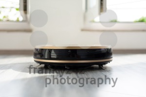 robotic vacuum cleaner on laminate wood floor - franky242 photography